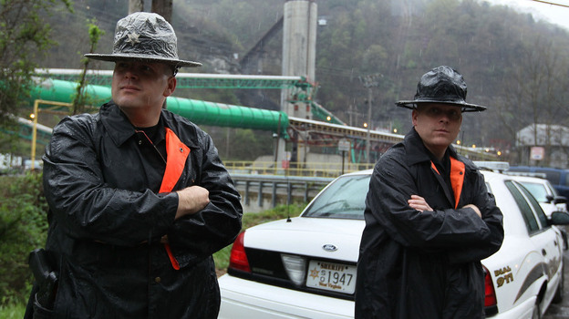 Two officers with the Raleigh County Sheriff's Office stand guard in front of the Upper Big Branch coal mine several days after the April 5, 2010, explosion that killed 29 workers in Montcoal, W.Va. (Getty Images)