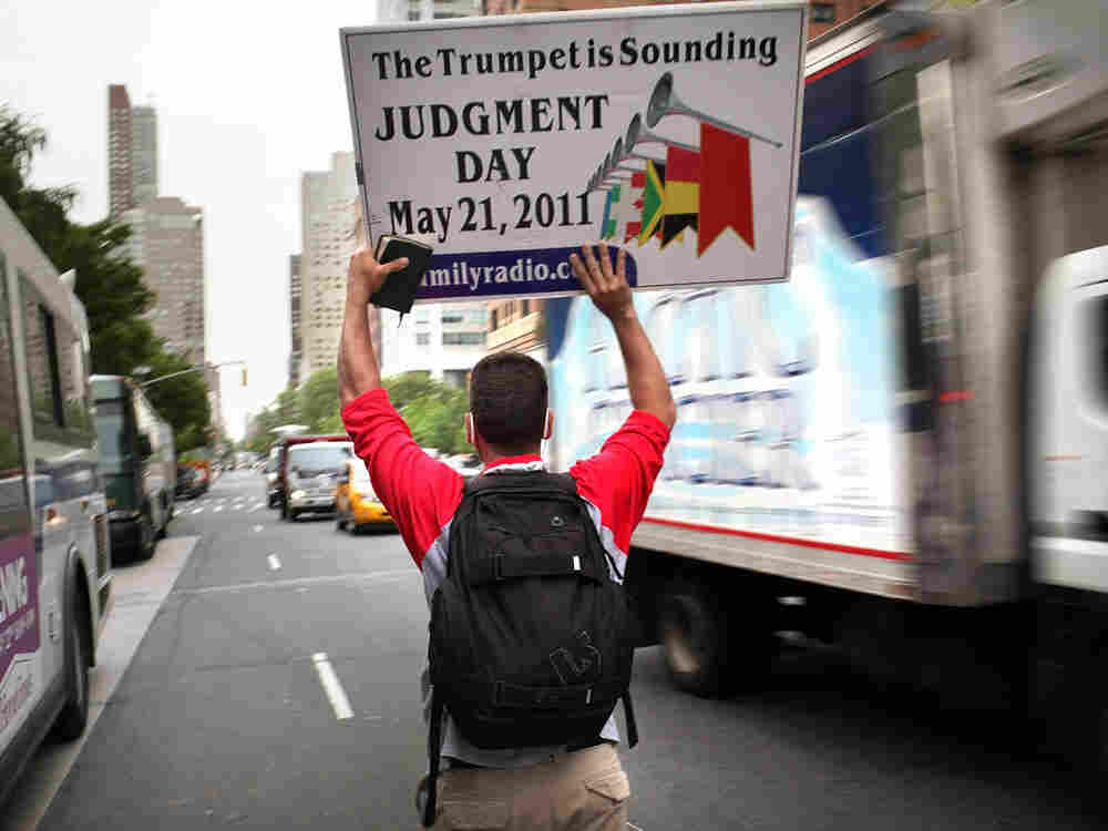 Participants in a movement that warns that May 21 is Judgment Day, walk through the streets on May 13, 2011 in New York City. In our second hour, eschatologist Jerry Walls examines our fascination with the end of times.