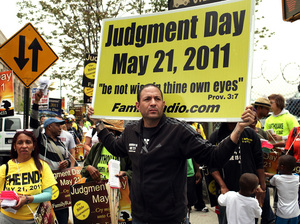 Participants in a movement that believes Judgment Day is May 21, 2011 gather on a street corner  in New York.