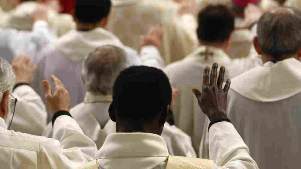 Priests follow a Mass at the Vatican. The clergy sex abuse scandal that erupted in Boston in 2002 has cost U.S. dioceses nearly $3 billion and has spread to Europe and beyond.