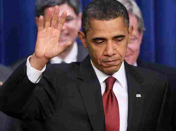 President Barack Obama waves after signing the Tax Relief, Unemployment Insurance Reauthorization and Job Creation Act of 2010 into law. The bill  extended the Bush tax cuts for two years and unemployment benefits for 13 months, but in more recent days the president has proposed a balance of tax hikes and spending cuts.
