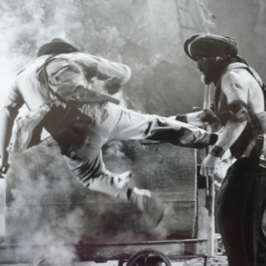 Vic Armstrong performed stunts for Harrison Ford, as Indiana Jones. Here he fights Pat Roach's goliath Indian guard.