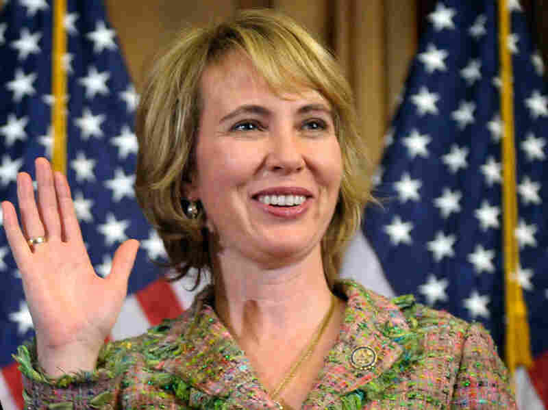 In this Jan. 5, 2011 file photo, Rep. Gabrielle Giffords,  D-Ariz., takes part in a reenactment of her swearing-in, on Capitol  Hill in Washington.
