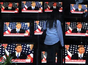 An Egyptian woman watches President Obama's policy address, outside a shop selling televisions in Cairo on Thursday.
