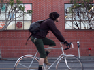 A bicyclist on the move in San Francisco.