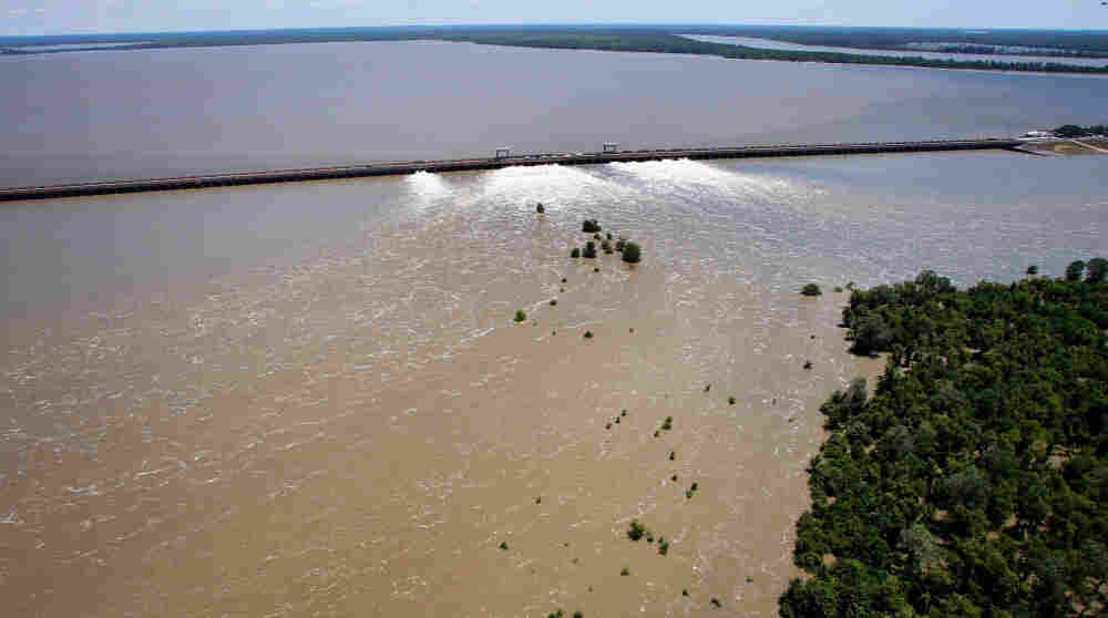 Water from the Mississippi River rushes out of open bays on the Morganza Spillway and into a  pasture in Morganza, La., on Monday, May 16, 2011.