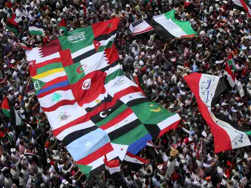 Egyptian demonstrators hold the flags of Arab nations at Cairo's Tahrir Square on May 13, 2011. Protesters called for national unity after attacks on Egyptian churches, and solidarity with the Palestinians as they mark the 'Nakba' or 'catastrophe' which befell them following Israel's establishment in 1948.