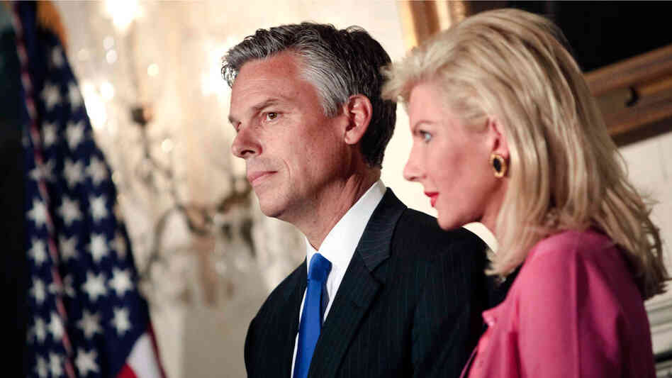 Jon Huntsman and his wife, Mary Kaye, listen in May 2009 as President Obama announces that he's tapping the Utah governor to be the U.S. ambassador to China. Huntsman is the latest Republican to formally test the waters for a presidential run.