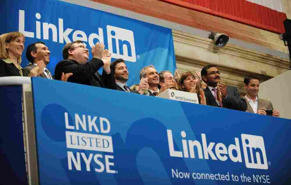 Linkedin founder Reid Garrett Hoffman (center and CEO Jeff Weiner (2nd right) at the ringing of the opening bell of the New York Stock Exchange May 19, 2011.
