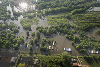 Floodwaters inundate homes in Vicksburg, Miss., on Wednesday.