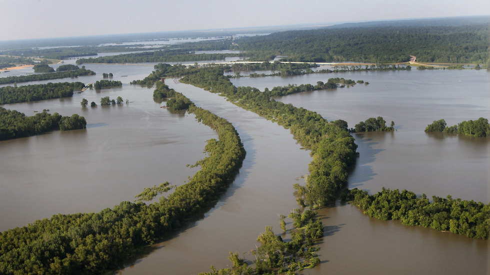 A wider aerial photo shows how the flooded Mississippi River has forced the Yazoo River to top its banks where the two meet near Vicksburg, Miss., causing towns and farms upstream to flood on Wednesday.