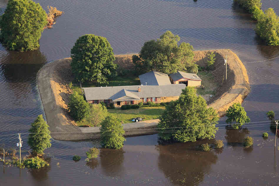 Photos show levees surrounding homes in Vicksburg, Miss., May 18, 2011.