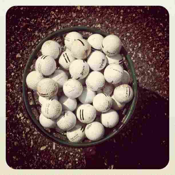A photo of a bucket of golf balls I took last month. Or 20 years ago.
