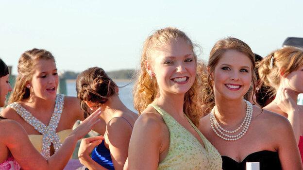 Contestants Emily Garvin and Kalynn Higginbotham pose  during the Miss Shrimp Festival pageant in Fernandina Beach, Fla.