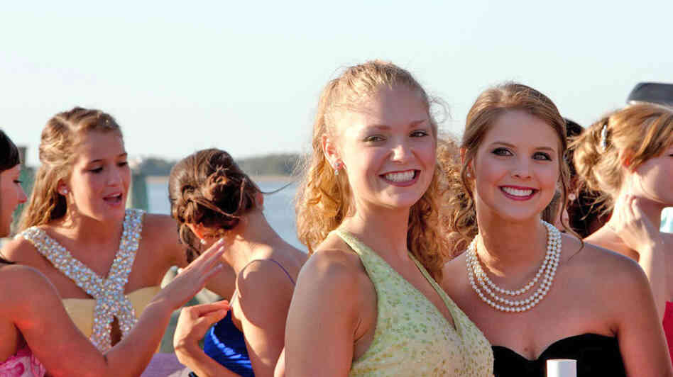 Contestants Emily Garvin and Kalynn Higginbotham pose  during the Miss Shrimp Festival pageant in Fernandina Beach, Fla.