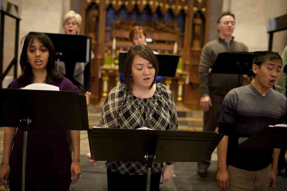 Members of Conspirare rehearse. The pieces they perform include works by Renaissance composers Josquin Des Prez, Orlandus Lassus, Tomás Luis de Victoria, and J.S. Bach, as well as a modern musical response by Kyr.