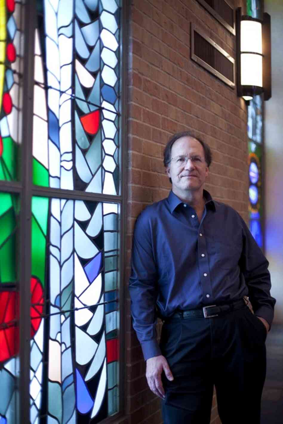 "Robert Kyr poses in St. Martin's Lutheran Church in Austin, Texas.  Kyr, the composer-in-residence for the concert series  ""Renaissance and Response"", created original music for the concerts.  Kyr's compositions were performed by the choral group Conspirare."