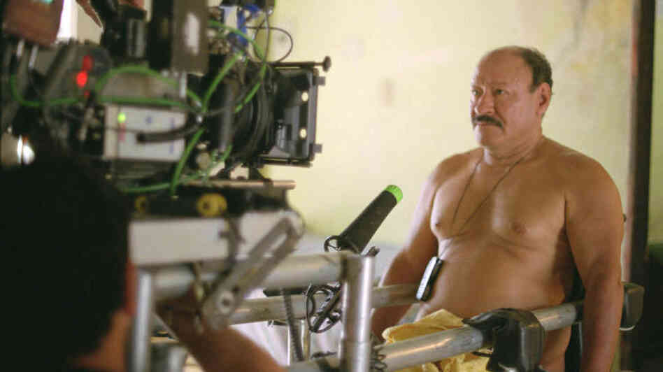 Porfirio Ramirez sits before the camera on the set of the movie Porfirio, in which he plays himself. In 2005, Ramirez hijacked a Colombian airplane and demanded compensation from the government for the injury that paralyzed him. He claimed rogue police officers had shot him.