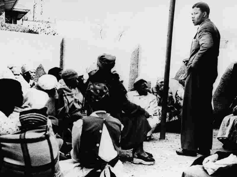 Nelson Mandela talks to a group of women demonstrating against the pass laws in South Africa in 1959.