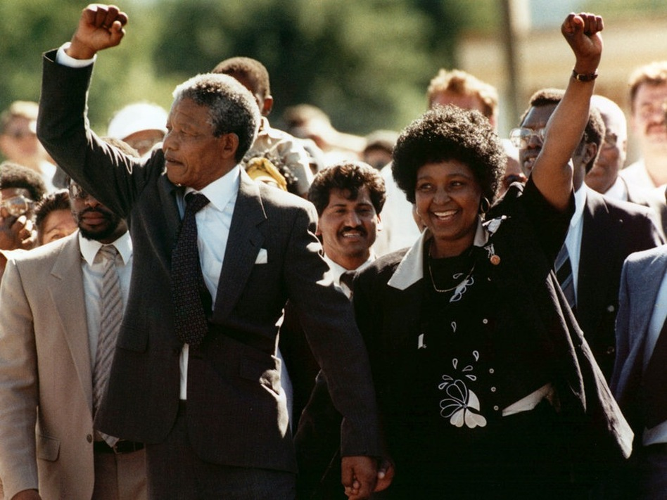 Mandela and his wife Winnie greet the crowd upon his release from Victor prison in Cape Town on Feb. 11, 1990 after serving 27 years in jail.