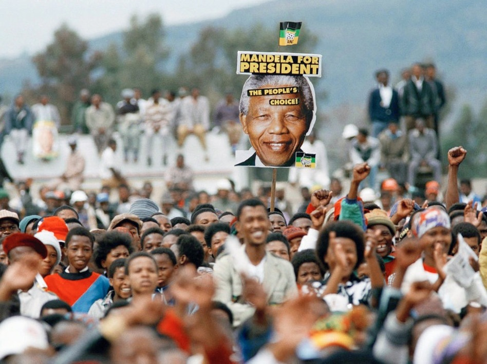 Mandela supporters cheer during an election rally in Thaba Nchu, South Africa on April 21, 1994.