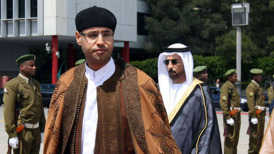Saif al-Islam Kadhafi, son of Libyan leader Moamer Kadhafi, waits for the arrival of Abu Dhabi Crown Prince Sheikh Mohammed bin Zayed al-Nahayan at Tripoli International Airport on April 5, 2008.