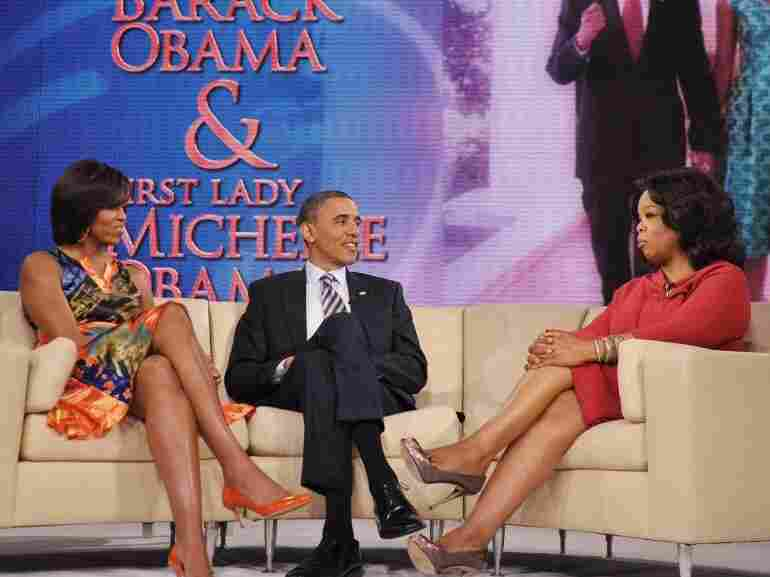 Oprah Winfrey talks with President Obama and first lady Michelle Obama  during a taping of the Oprah Winfrey show in April. The final episode of Winfrey's 25-year-old talk show airs Wednesday.