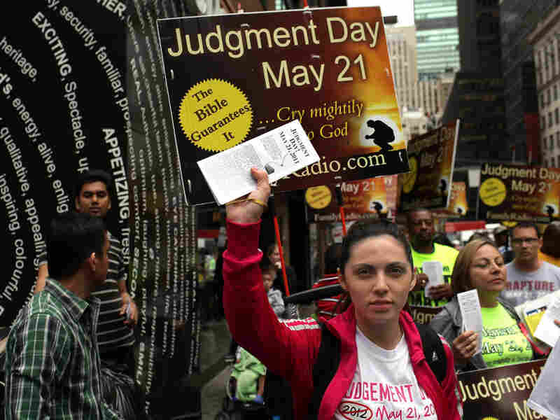 Believers in New York City hand out literature on May 13, warning that the world would end on Saturday, May 21. Judgment Day did not come but popular Google searches show a preoccupation with the disappointment of those who awaited the event.