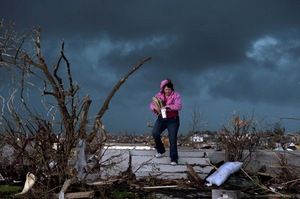 "Janet Martin attempts to salvage items from her brother's home in Joplin. ""Twenty minutes before the storm, he left to go to church.  He would have been in that basement if he hadn't gone,"" Martin said."