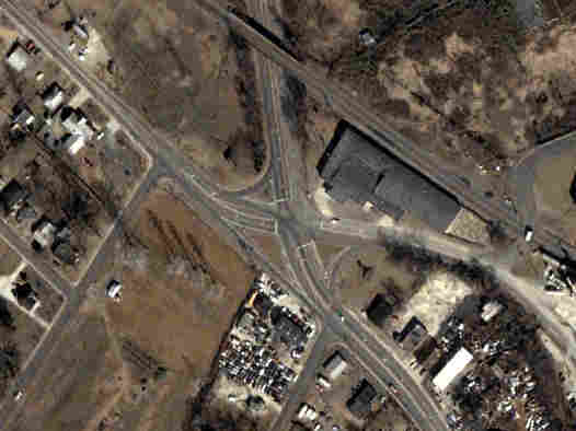 An aerial photograph shows the Rozzelles Ferry Road and W. Trade Street intersection, before it was improved.