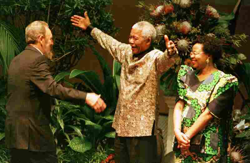 Mandela and his second wife, Graca Machel, greet Cuban President Fidel Castro, left,  at the 12th Non-Aligned Movement Summit meeting, Sept. 2, 1998.