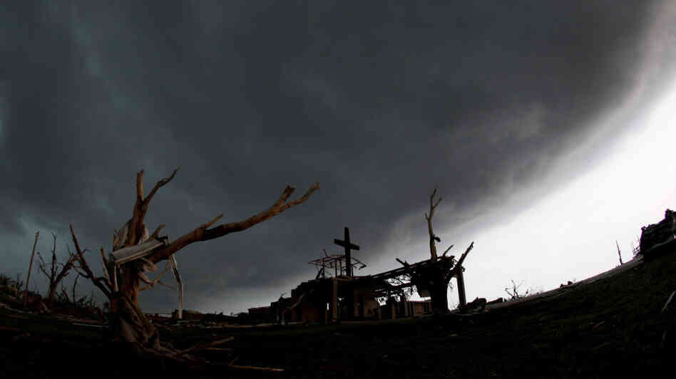 A cross stood atop a church that was severely damaged by a tornado Sunday in Joplin, Mo., as a severe storm passed overhead earlier today (May 23, 2011).