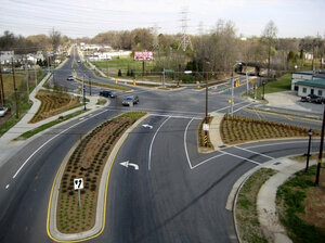 Cities like Charlotte, N.C., are moving to improve roadways for pedestrians and cyclists. Above, a street project on Rozzelles Ferry Road, which now
