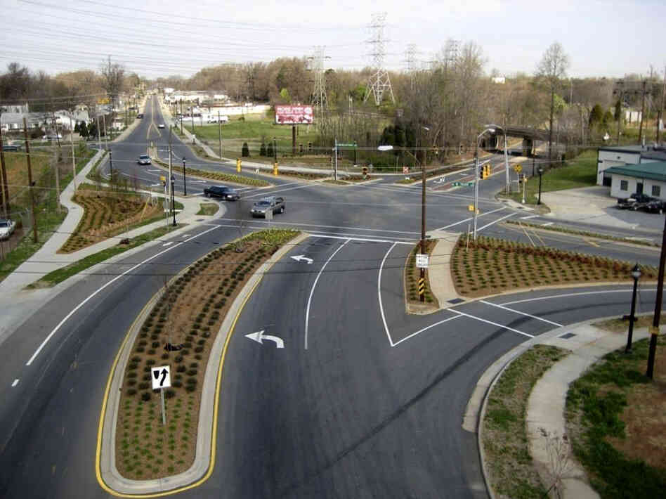 Cities like Charlotte, N.C., are moving to improve roadways for pedestrians and cyclists. Above, a street project on Rozzelles Ferry Road, which now has bike lanes and extended sidewalks. Below, an aerial pho