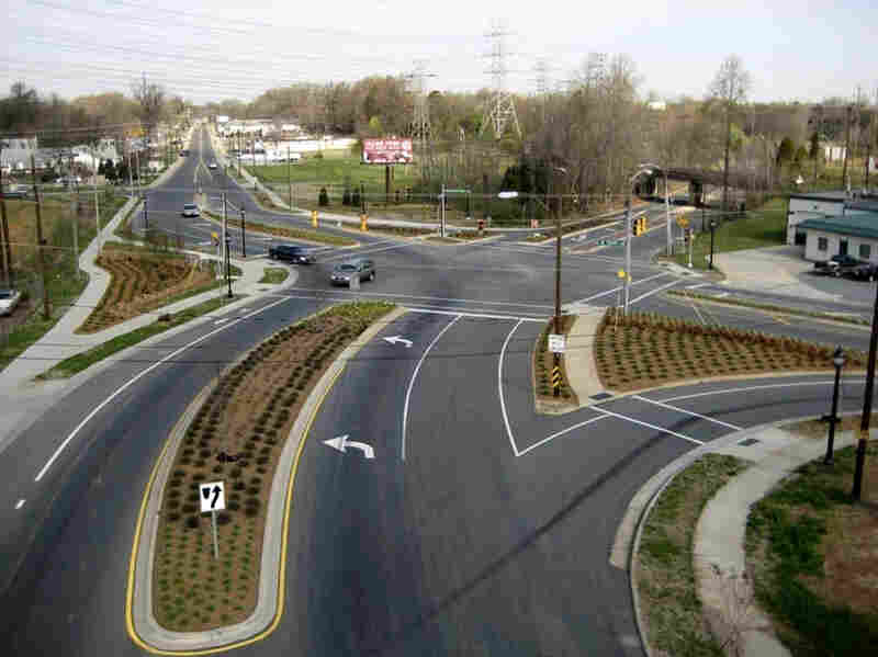 Cities like Charlotte, N.C., are moving to improve roadways for pedestrians and cyclists. Above, a street project on Rozzelles Ferry Road, which now has bike lanes and extended sidewalks. Below, an aerial photo of the intersection before work began.