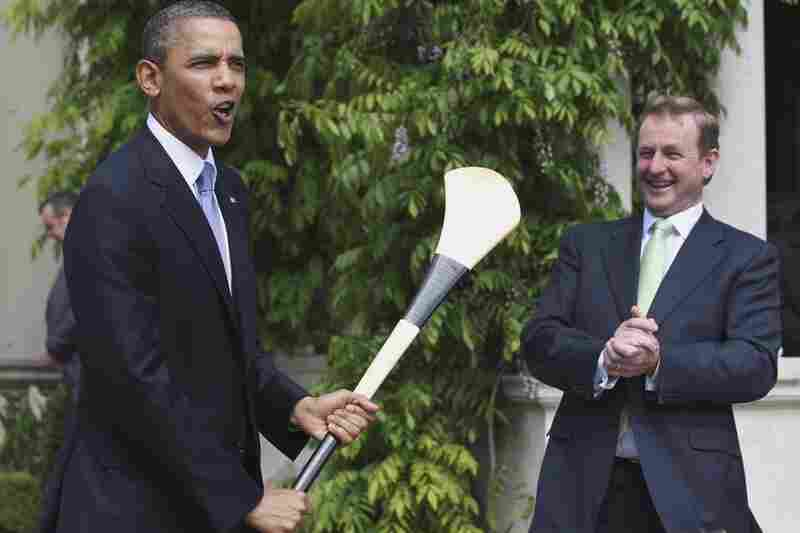 Irish Prime Minister Enda Kenny presents Obama with a hurley stick — used in the Irish national sport of hurling — while at Farmleigh, Dublin.