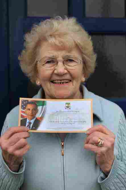 Moneygall resident Maura Slater poses with her official ticket to see Obama during his visit.