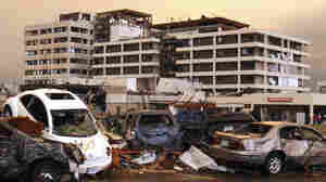 Destroyed vehicles are piled up in the parking lot of the Joplin Regional Medical Center in Joplin, Mo., after a tornado moved through the city, damaging the hospital and hundreds of homes and businesses.