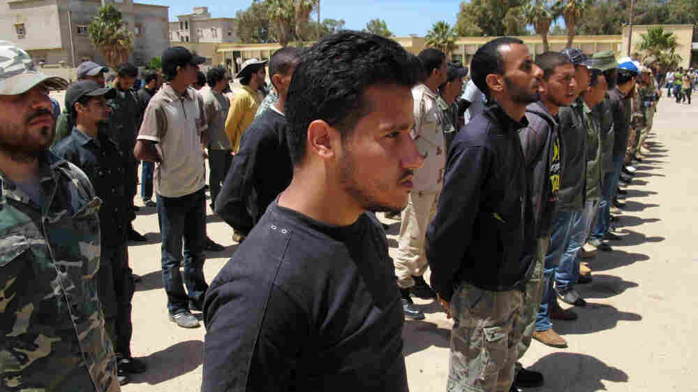 Volunteers attend a boot camp for rebels at a captured Libyan army base in Benghazi.  Those with some military experience train for a week or two; the rest get three weeks or more.