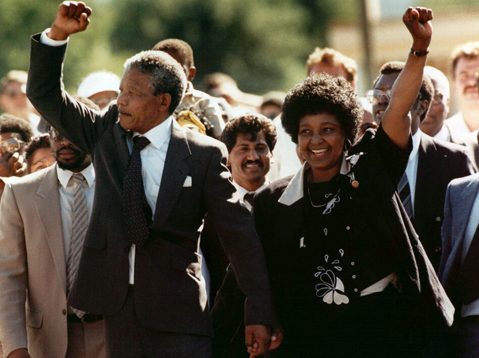 Nelson Mandela and his wife Winnie greet the crowd upon his release from Victor prison in Cape Town on Feb. 11, 1990 after serving 27 years in jail.