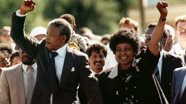 Nelson Mandela and his wife Winnie greet the crowd upon his release from Victor prison in Cape Town on Feb. 11, 1990 after serving 27 years in jail. (AP)