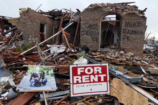 Graffiti informs rescuers that everyone is safe and accounted for at the site of a destroyed home on Monday in Joplin, Mo.  (AP)