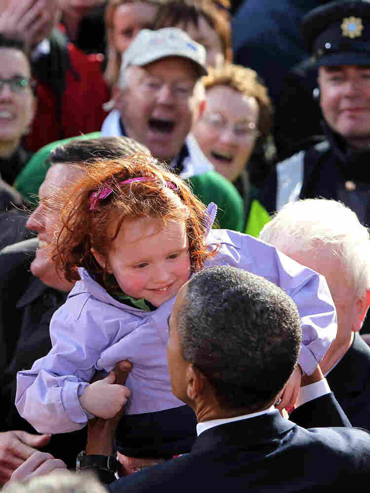 President Obama admires an Irish toddler to the delight of the crowd.