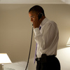 President Obama talks on the phone with Missouri Gov. Jay Nixon, during his visit to Dublin on Monday.