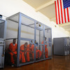 Inmates at California's Chino State Prison sit inside a metal cage in the hallway as they wait to be assigned permanent housing or for medical, mental health, counselor or other appointments.