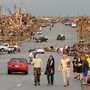 Residents of Joplin, Mo., walk west on 26th Street near Maiden Lane after a tornado hit the southwest Missouri city Sunday evening.