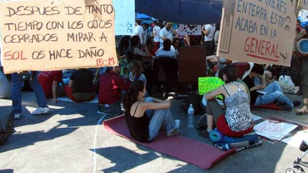 An urban encampment has sprung up in Madrid's central square, Puerta del Sol. The sit-in, which started a week ago, has rapidly grown in size. (NPR)