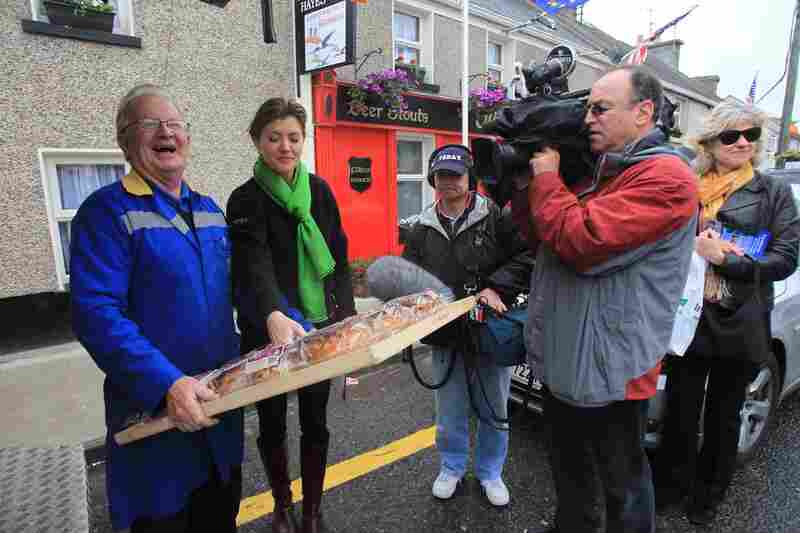 Moneygall resident Joseph Kearney is filmed by the Today show as he delivers Obama-themed brack bread.