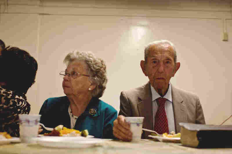 After his last sermon on May 15, Camping and his wife enjoy a final meal with the congregation.