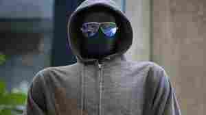 The hoodie and sunglasses used by Ted Kaczynski, also known as the Unabomber, are displayed as Kaczynski's personal items are auctioned off online. Proceeds will benefit the victims' families.